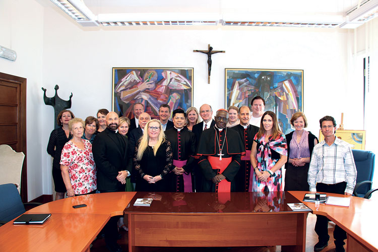 In the presence of Cross Catholic Outreach staff and donors, Cardinal Sarah leads the signing of Canonical Statutes in 2015. This event formalizes Cross Catholic Outreach as a legal entity within the Church.