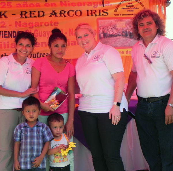 Marisela and her children are presented with the keys to their new home.