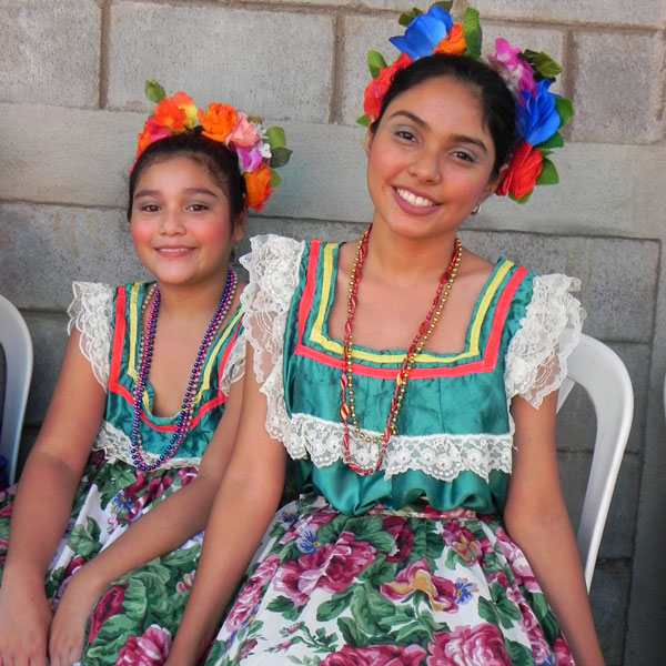 Nicaraguans wear traditional clothing to celebrate the completion of the new homes.