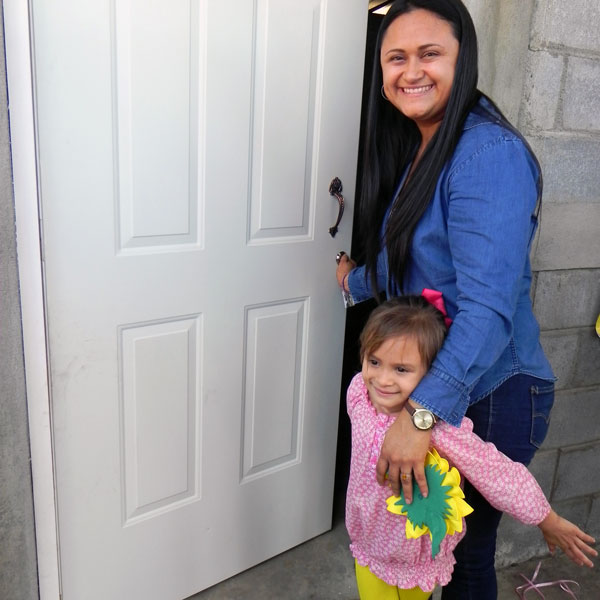 Ana and her daughter receive their new home.