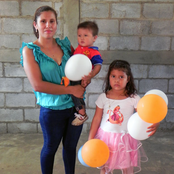 Rebeca and her family receive their new home.