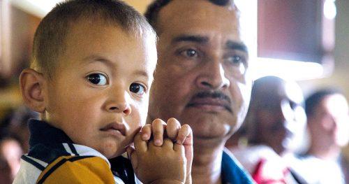 A Guatemalan boy seated at a Catholic Mass