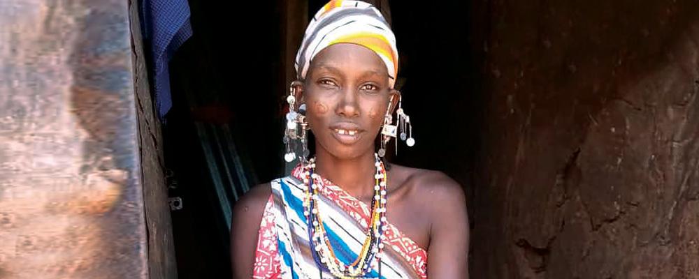 Katita Shuaka sits at her home in Orkung'u, Kenya.