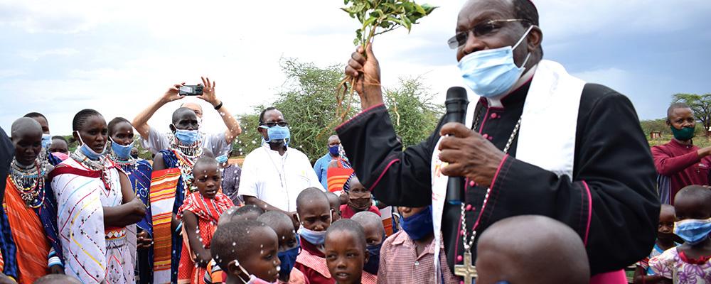 Archbishop Martin Kivuva Musonde blesses children in Orkung'u, Kenya.