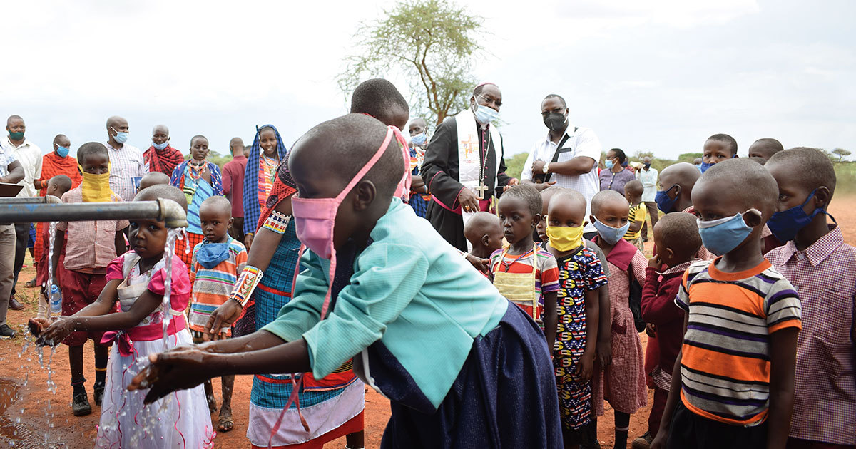 Children wash their hands at the water kiosk in Orkung'u, Kenya.