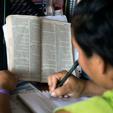 Woman studying her Bible.