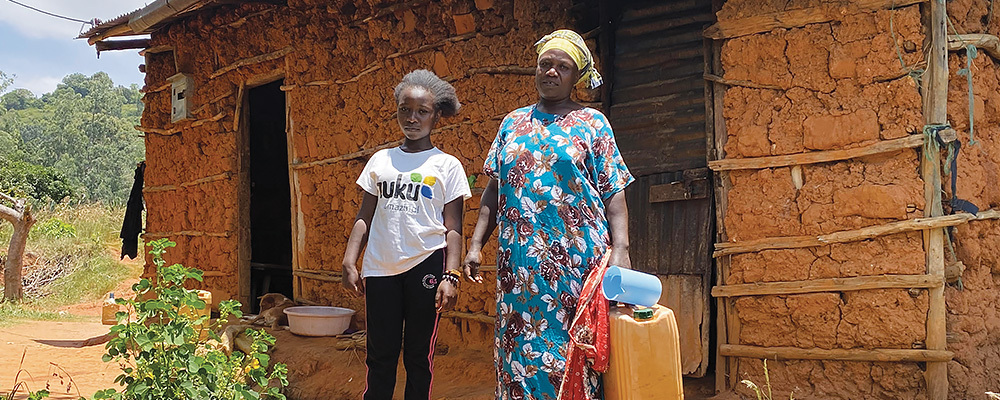 Agnes Mwaka Matenge and her daughter, Defence, outside their home in Sagalla, Kenya