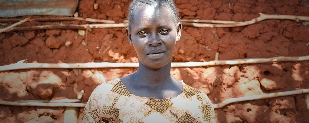 Eunice Kathumbe Thiani outside her home in Kamtonga, Kenya