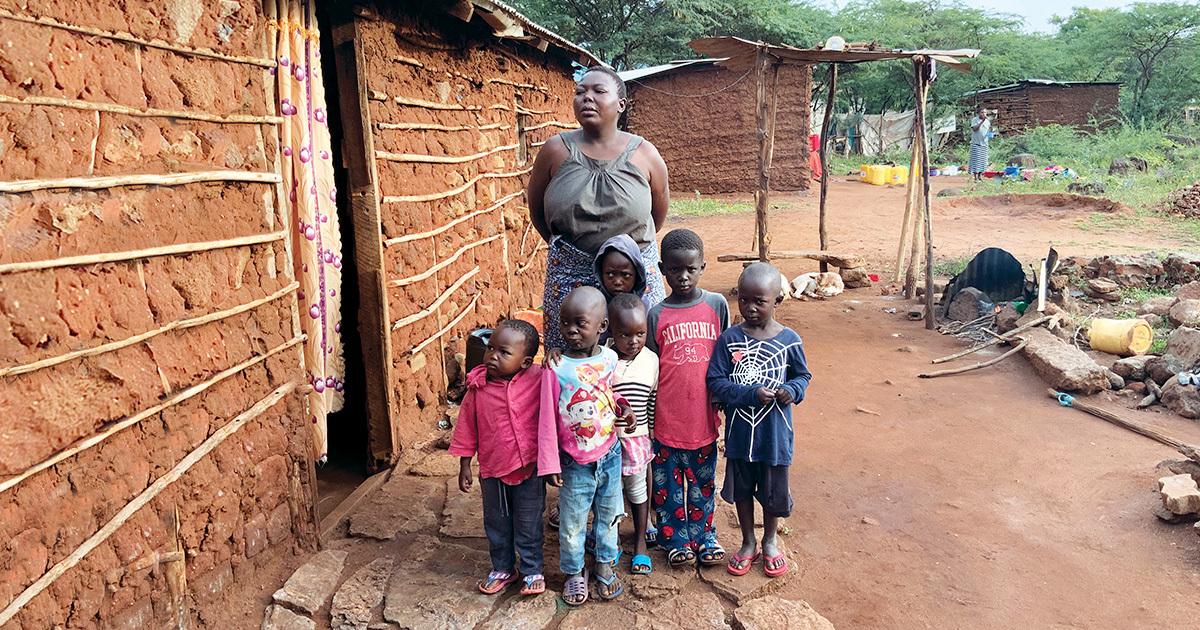 Pauline Mukabi with six children outside her home in Taveta, Kenya