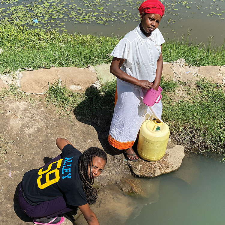 Angelina Ombam and friend collect water from a pond in the Diocese of Machakos, Kenya