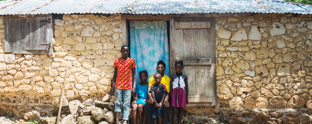 The Placide family and their crumbling mud house.