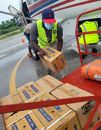 Men unloading a truckload of disaster relief items