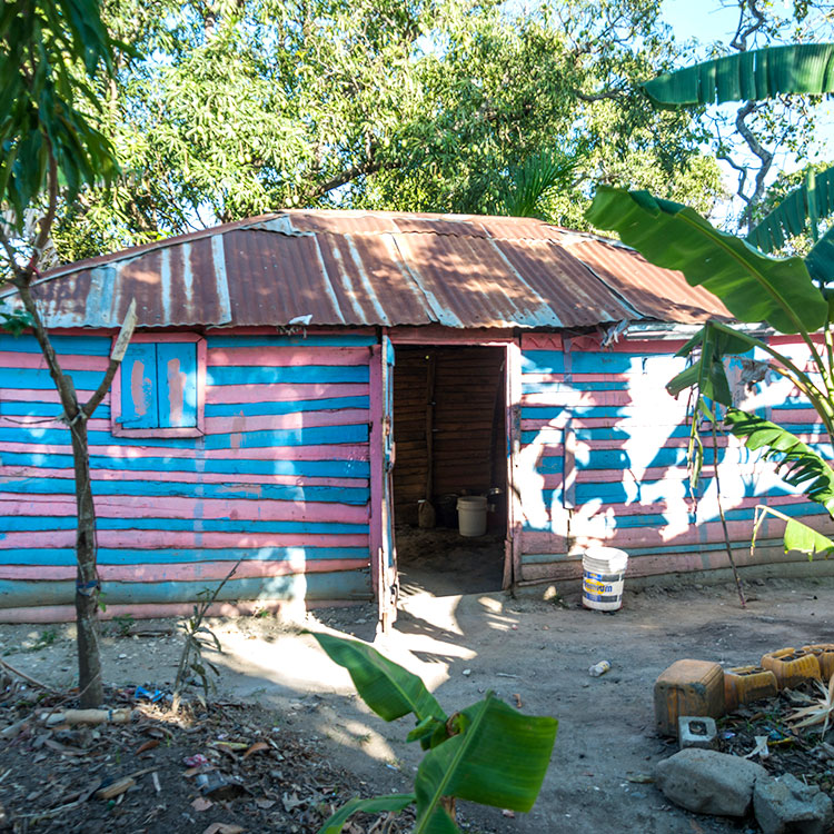 The Mission began building wooden homes with tin roofs for poor families.